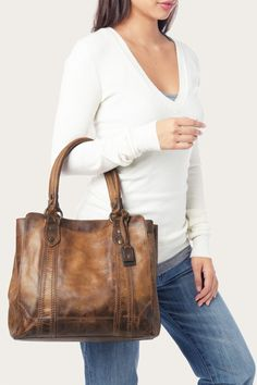 Made from beautiful pull up leather with our signature Melissa buttons, this tote bag is the perfect size for a hectic day or weekend away. The kind of carryall that gets even better with age. Using the same techniques and handcrafted care we've prided ourselves on since 1863, each Melissa is given the attention you've come to expect from Frye.