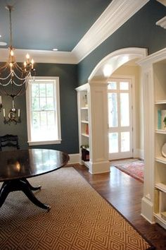 Archway to Kitchen-Bookshelfs love the color and the big trim!  this would be pretty going into the kitchen or a dinning room from the kitchen