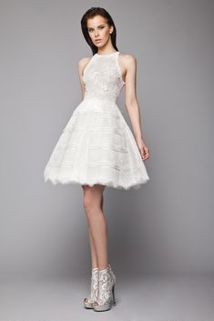 Short princess Off White dress in Tulle with halter neckline and horizontal ribbon bands on the skirt.