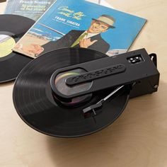 Plays vinyl records wirelessly via any FM receiver, lets you digitize your collection.