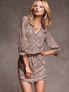 A perfect blend of boho-chic and glamour: meet the Sequin Blouson Dress from Victoria's Secret. The straight skirt perfectly complements the drapey blouson top, while the sexy V-neck and elbow-length sleeves are crowning touches.