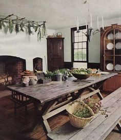 Beautiful use of a picnic table in a rustic kitchen