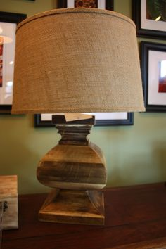 wooden, square base lamp with a burlap-style shade.
