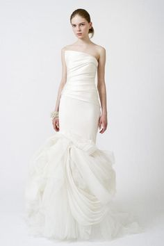 The Vera Wang 'Fiona' mermaid style organza/silk wedding gown is sure to be a showstopper. The asymmetrical fitted bodice adds a modern touch to this classic silhouette. The mermaid silhouette falls into cascading twists & turns or gorgeous chiffon. This dress is once worn and in excellent condition. [Section]