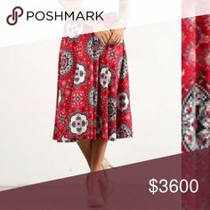 Red Geometric Midi Skirt Brand new with tag. Flowing midi skirt. Soon add pretty young thing Skirts Midi