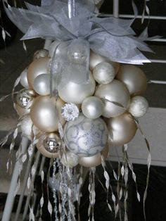 Hot glue ornaments to a foam ball~ hang over table, entry way, etc. by brendaq