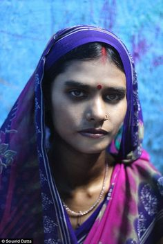 Born into brothels: Heartbreaking photos of Calcutta's notorious red-light district where thousands of girls are forced into sex work     Sonagachi slum in Calcutta, India, is one of Asia's largest red-light districts.     Estimated 12,000 girls under age of 18 are involved in sex trade in the notorious shantytown run by gangs.     London-based photographer Souvid Datta, 21, created series of photos called The Price of a Child shedding light on Sonagachi's sex industry.