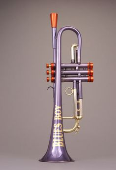 The Blues Boy Trumpet by Andy Taylor, Norewich 1995, has a wide bell throat, a design that later led to the Phat Boy series
