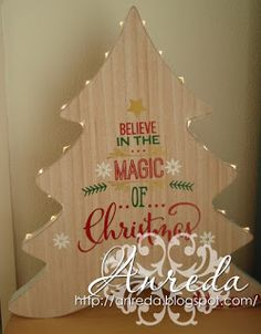 "It's beginning to look a lot like Christmas ...  Today we show you some gifts, these are Christmas 2015. Were still ready to place and ""suddenly"" it's already Christmas * lol *  A wooden Christmas tree with text ""believe in the magic of Christmas"" and lights along the edge."