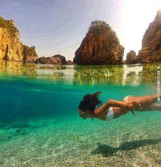 Crystal clear water in La Grotta Cove, Corfu Island, Greece.