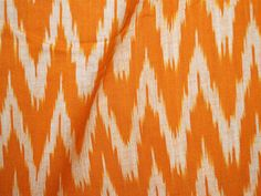 Ikat Cotton Fabric Handloom - Ikat Pattern in Orange and White Color