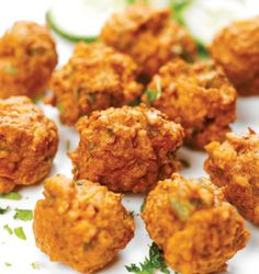 Pakora is a fried snack (fritter) found across South Asia.Pakoras are created by taking one or two ingredients such as onion, eggplant, potato, spinach, plantain, paneer, cauliflower, tomato, chilli, or occasionally bread or chicken and dipping them in a batter of gram flour and then deep-frying them. Pakoras are usually served as snacks or appetizers. In Britain, pakoras are popular as a fast food snack, available in Indian and Pakistani restaurants.
