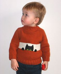 Child's pullover sweater for sale: Black cat peek-a-boo sweater, mostly knit from scarlet wool, made to order by Tuttolv, for sale on Etsy.com. Available in sizes 1T to 5T (posted Jan. 2014).