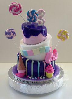 Topsy turvy candy themed birthday cake