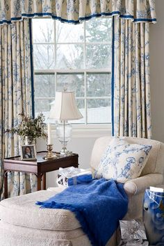The scalloped shirred valance & draperies in a pretty blue & white print look lovely with the white mattlasse chaise. The pillow & throw finish it off nicely.