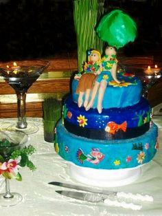 This fun theme cake was made for a Hawaiin wedding