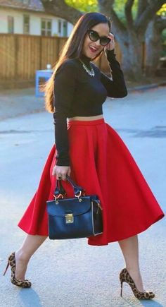 Long sleeve black crop and red circle skirt and add animal print pumps for some vavoom!