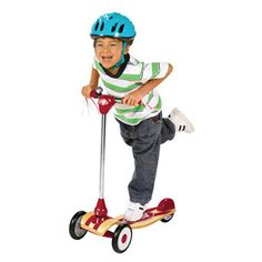 $89.99 - Get Scootn? • The new Radio Flyer Deluxe My 1st Scooter features • Sleek, modern styling with premium quality materials • Including a classic curved beech wood deck • A chrome steering column• Its patented three wheel design, extra wide riding platform and textured ergonomic rubber hand grip provides balance and safety for beginner riders, while the classic ringing bell and flowing streamers provide an element of fun.• Weight capacity 50 lbs.• Measures approximately 2...