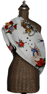 An adjustable baby sling my friend got me hip to. I love the tattoo theme of the print.
