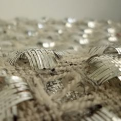 This is s scarf in combination of metallic and wool yarn. Habu Textiles