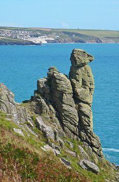Dog Rock outcrop at Trewavas Head in Cornwall with Porthleven in the background.