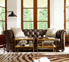 with its sheltering arms and deeply tufted upholstery the sofa is synonymous with comfort our leather sofa retains all the fine points of the