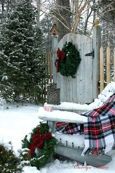 Old Wooden Garden Gate...with a pine wreath...old chair with plaid throw...snow.