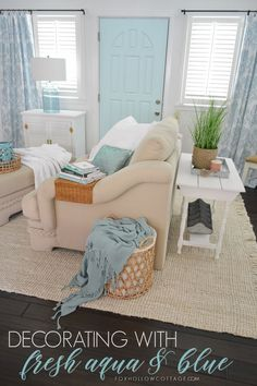 Fresh, airy, aqua blue home decorating refresh with painted door, curtains, lamps and decor accessories. Simple and budget friendly room makeover with coastal cottage feel. Color layered over a neutral base for a causal relaxed home.