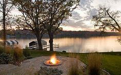 Top DIY Inspiring Fire Pit Designs for Outdoor Space: Lake House With An Outdoor Patio And Firepit ~ jillyshappyhome.com Decorating Inspiration