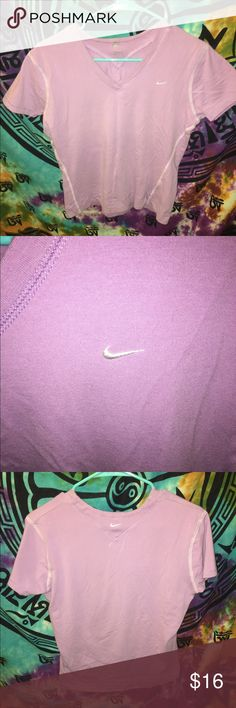 Nike V Neck Athletic Shirt Purple Top Blouse Women's size Small. This Light Purple Nike v neck shirt is in good condition!  -Nike -Just Do It -Light Purple -Classic Logo on chest and back -Top / Blouse / T Shirt / Shirt / V Neck Nike Tops Tees - Short Sleeve