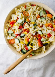 QUICK N' HEALTHY CHICKPEA + VEGETABLE PASTA SALAD - THE SIMPLE VEGANISTA... A classic pasta salad with a garlic-lemon dressing. Chickpeas are added for extra protein, and because they are just so good! This will feed a crowd and can be made in advance. Enjoy!