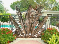 Love this metal pool gate with a custom leaf design.  Very tropical!