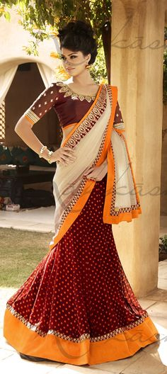 133667: Red and Maroon, Beige and Brown color family Saree with matching unstitched blouse.