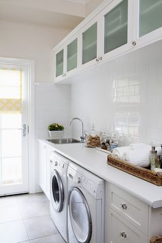 Laundry idea. Bench on one side, with under bench washer and dryer. Other side is floor to ceiling cupboards