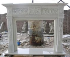 thegatz - Classic Hand Carved Marble Fireplace Mantel, White Marble 10-07710, $3,200.00 (http://www.thegatz.com/classic-hand-carved-marble-fireplace-mantel-white-marble-10-07710/)