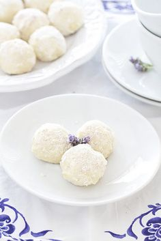 coconut lavender cookie balls...Ingredients:  1 cup unsalted butter (2 sticks), softened  1/4 cup confectioners' sugar, plus more for dusting  2 cups all-purpose flour  1/4 teaspoon salt  2 cups sweetened flaked coconut  2 teaspoons fresh lavender, minced