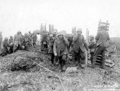 Some German prisoner help carrying Canadian wounded soldier away from the battle field. This shows humanity and helping each other- by Omen and Daniel CHC 2P1-14