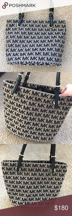 Brand New Michael Kors Purse Brand new with tag Michael Kors purse. Black writing and straps and light brown colored purse. Great condition. Pockets inside. Authentic. Michael Kors Bags