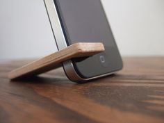 I need to make one of these out of plastic so it fits in my wallet!  wood iPhone 4 and 4S stand.  cherry with charcoal.. $17.00, via Etsy.