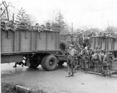 """Paratroopers of the 101st Airborne Division load up on large """"cattle car"""" trucks the afternoon of December 18, 1944 for the trip - Imgur"""