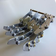 How To: Make a Mechanical Hand: 11 Steps (with Pictures) Mechanical Hand, Mechanical Design, Robot Hand, Hobbies That Make Money, Robots, Cosplay, Homeschool, Wood, Pictures