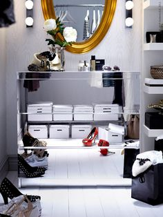 super cool mirrored dresser, love the gold mirror accent