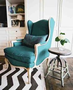Love the color of the chair, and the chevron rug is right up my alley.