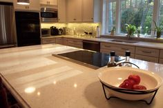 Very attractive kitchen designed by the Silestone Bianco River. White shaker cabinets and travertine backsplash embellish the kitchen. The huge window in front of the sink area allows getting more daylight during the day. Quartz Kitchen Countertops, Travertine Backsplash, Mosaic Backsplash, Kitchen Cabinets, Tile, White Shaker Cabinets, White Cupboards, Huge Windows, Kitchen Design