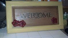 Welcome sign made out of old cabinet door