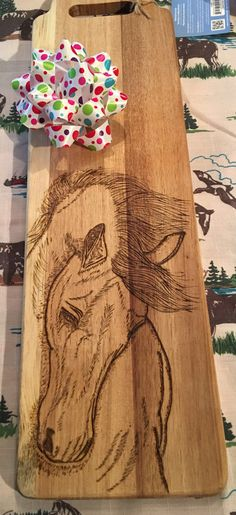A personal favorite from my Etsy shop https://www.etsy.com/listing/486829555/long-cutting-board-wood-burned-with-a
