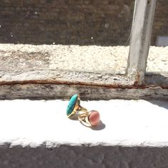 Turquoise and coral rings sitting pretty on the window sill. Love these two! #finejewellery #luxury #turquoisering