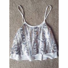 Charolette Russe Sequin Top Sequin too. Spaghetti straps; not adjustable. Two layer shirt, bottom layer is plain white and top layer ha sequin design. Heavier shirt. Still comfy! Very cute and girly. Never worn. No flaws! Charlotte Russe Tops