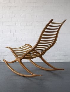 Robin Williams rocking chair: A Wishbone rocking chair designed and made by Robin Williams in the late 1970s. A very elegant, beautifully crafted chair with a well balanced rocking action.