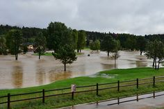 eptrail > Floodwater from the Big Thompson River cover the 9-hole golf course in Estes Park Friday morning, Sept. 13.